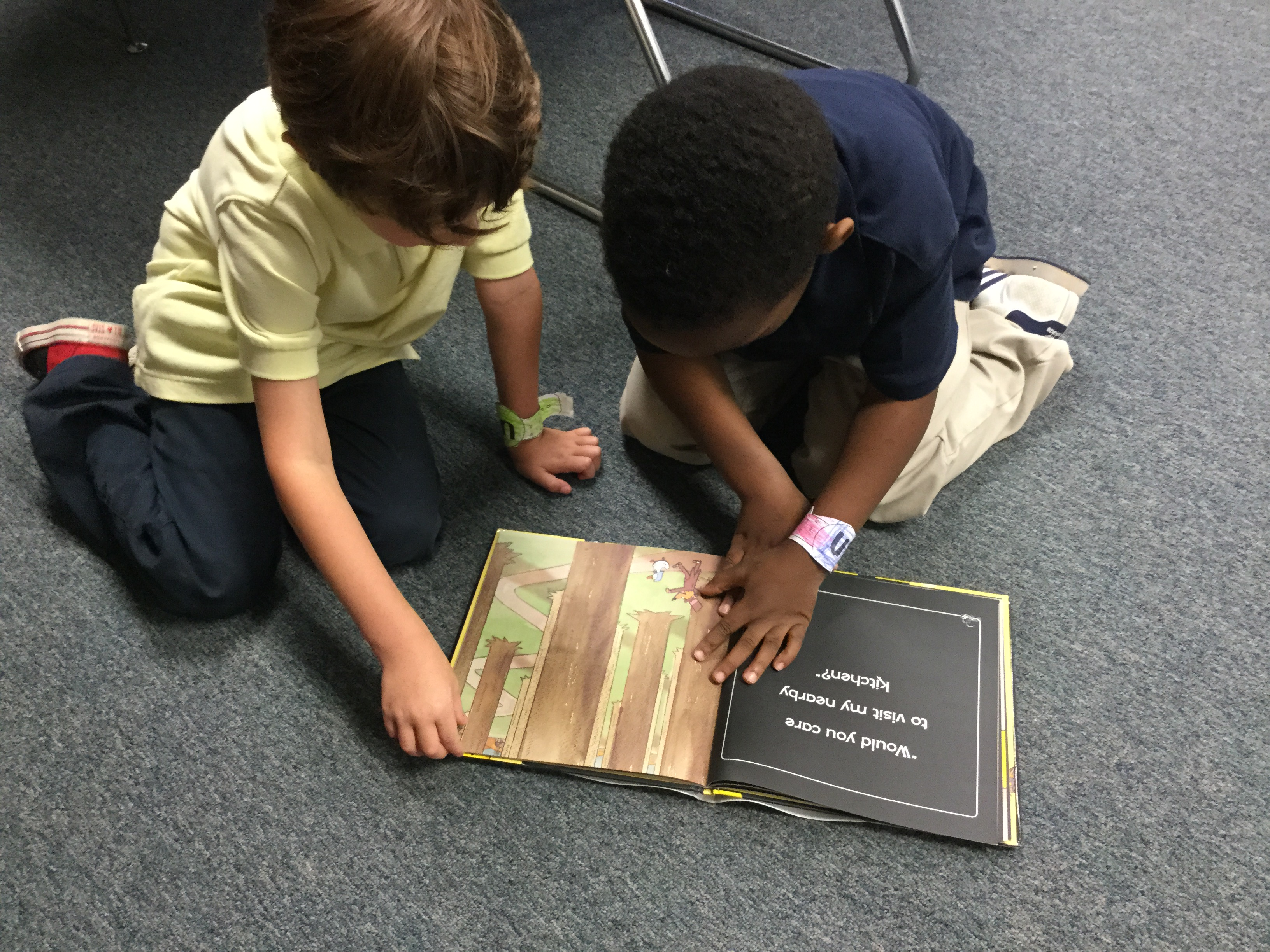 Enjoying library center activities: partner reading